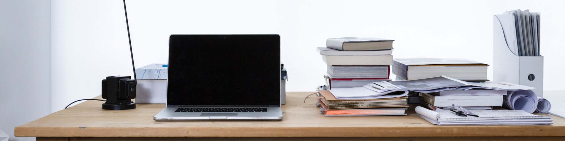 bg-desktop-view-with-books-papers-and-laptop